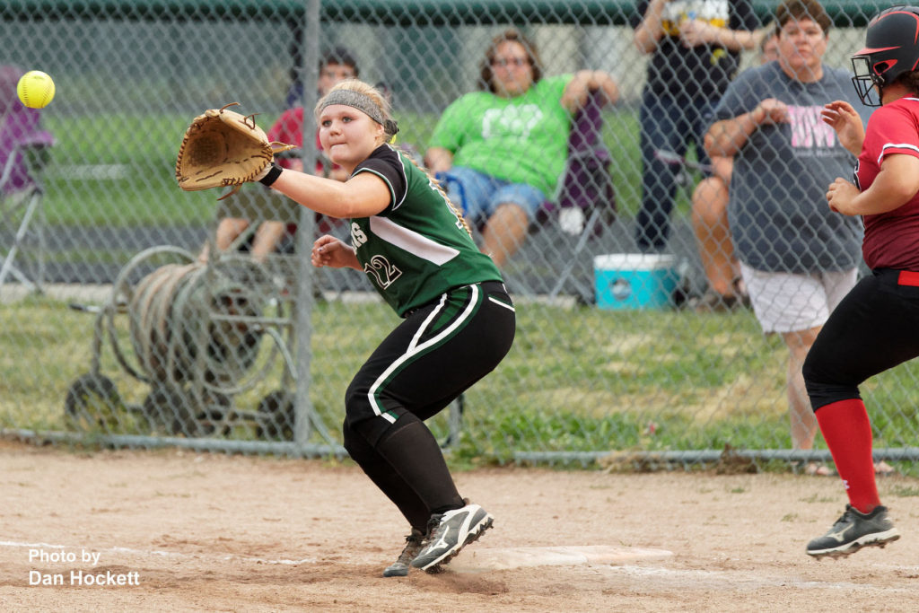 Photo by Dan Hockett West Burlington – Notre Dame First Baseman Cassie Powers (12) gets the out against Winfield – Mt. Union Wednesday night in West Burlington. WBND defeated WMU, 4-2.