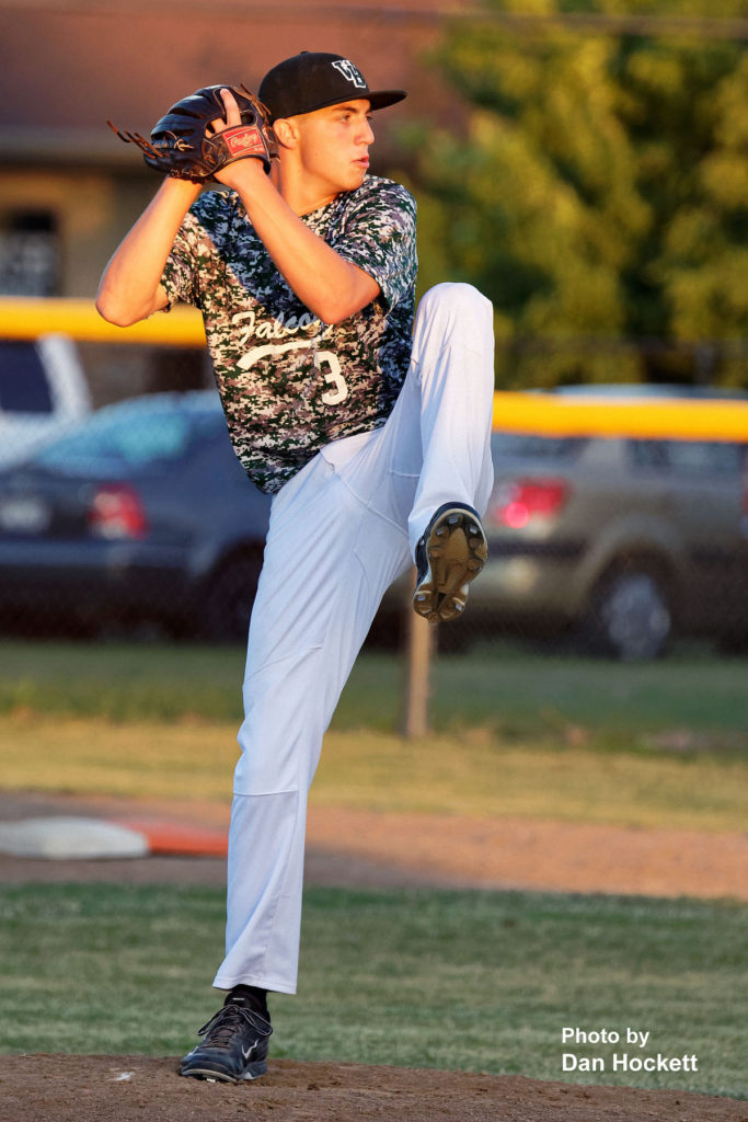 Photo by Dan Hockett West Burlington Pitcher Drake Day winds up before sending the ball to the plate against Notre Dame Thursday night in Burlington. Notre Dame defeated West Burlington, 3-1.