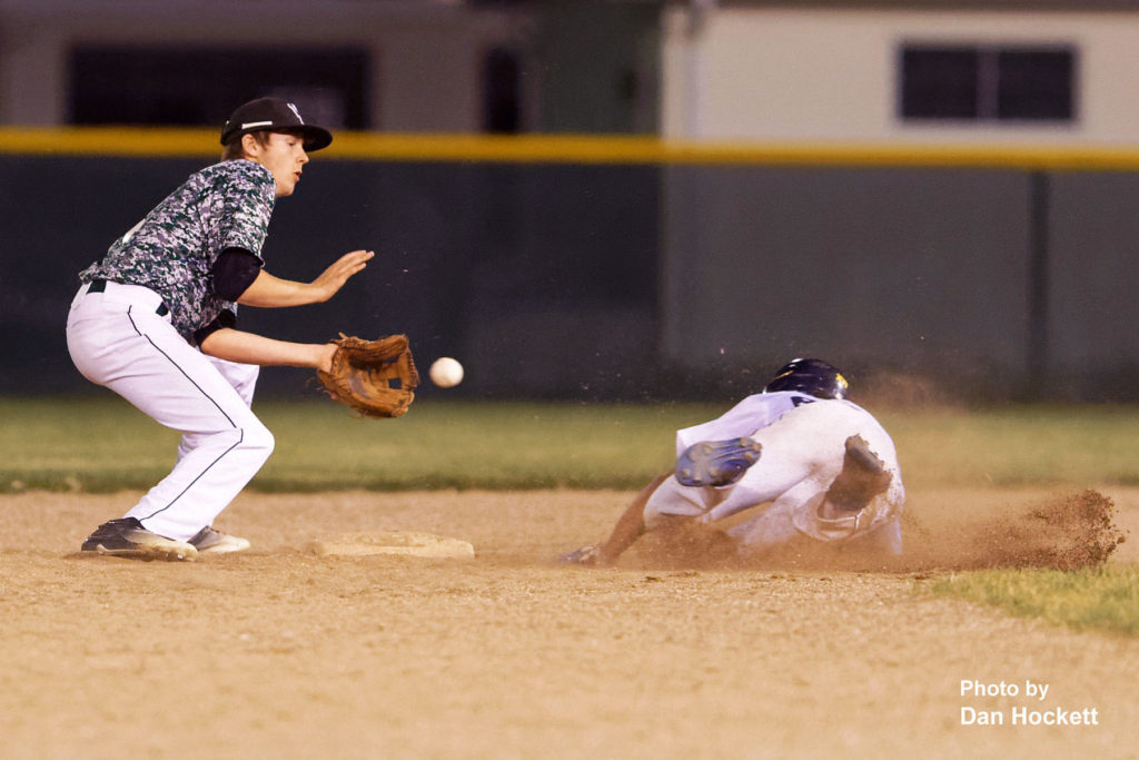 Photo by Dan Hockett Notre Dame's Xander Williams slides safe in to second when West Burlington Second Baseman Drew Pence drops the ball in the sixth inning at West Burlington. Game was moved to West Burlington in the sixth inning after a power outage at Notre Dame's field Thursday night in Burlington. Notre Dame defeated West Burlington, 3-1.