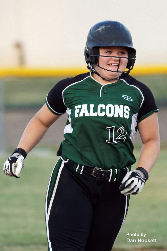 Photo by Dan Hockett West Burlington's Cassie Powers smiles after hitting a homerun in fifth inning against Van Buren Friday night in West Burlington. West Burlington defeated Van Buren, 14-4, in 5-innings.