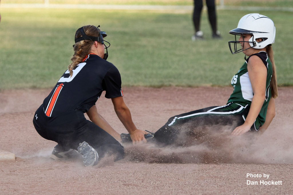 Photo by Dan Hockett Mediapolis Shortstop Brianna Eberhardt (9) tags West Burlington – Notre Dame's Kiera Brown out while trying to steal second Monday night in West Burlington. Mediapolis defeated West Burlington – Notre Dame, 11-0.