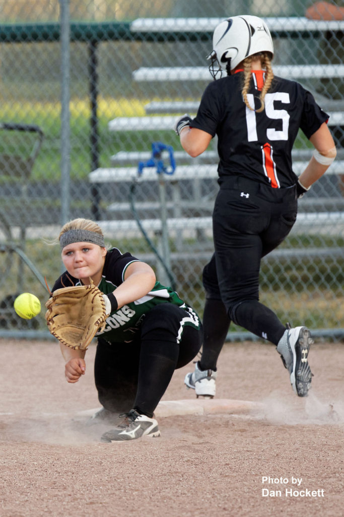 Photo by Dan Hockett Mediapolis' Mackenzie Petty beats the throw to West Burlington – Notre Dame First Baseman Cassie Powers for a single Monday night in West Burlington. Mediapolis defeated West Burlington – Notre Dame, 11-0.