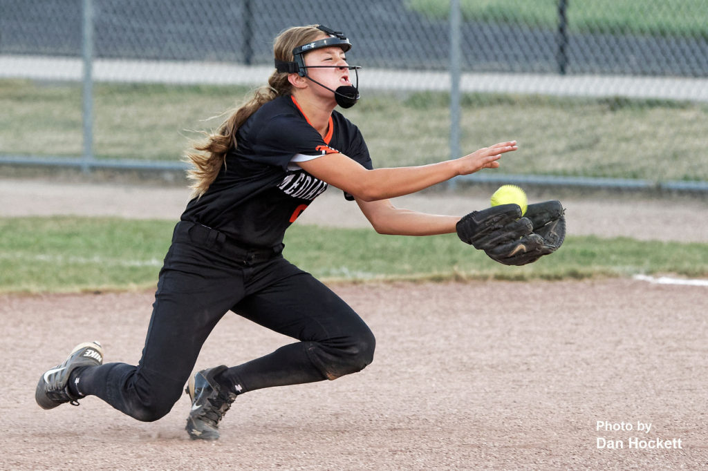 Photo by Dan Hockett Mediapolis Second Baseman Maggie Myers makes a diving catch for an out against West Burlington – Notre Dame Monday night in West Burlington. Mediapolis defeated West Burlington – Notre Dame, 11-0.