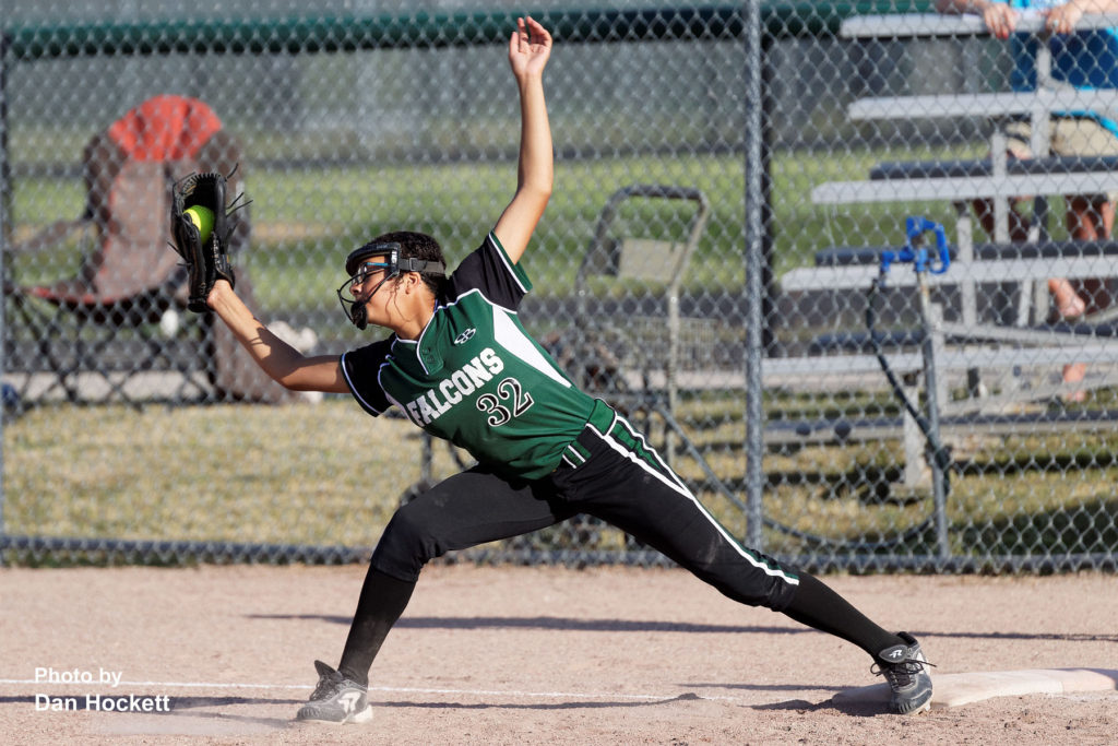 Photo by Dan Hockett West Burlington – Notre Dame First Baseman Olivia Baker reaches for the out against Mt. Pleasant Wednesday in West Burlington. Mt. Pleasant defeated WBND, 5-3, 19-12.