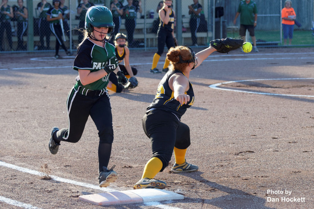 Photo by Dan Hockett West Burlington – Notre Dame's Makenna Davis is safe after Central Lee First Baseman Allison Brisby bobbles the ball in Class 3A, Region-4 quarterfinal, Tuesday night in West Burlington. West Burlington – Notre Dame defeated Central Lee, 9-1.