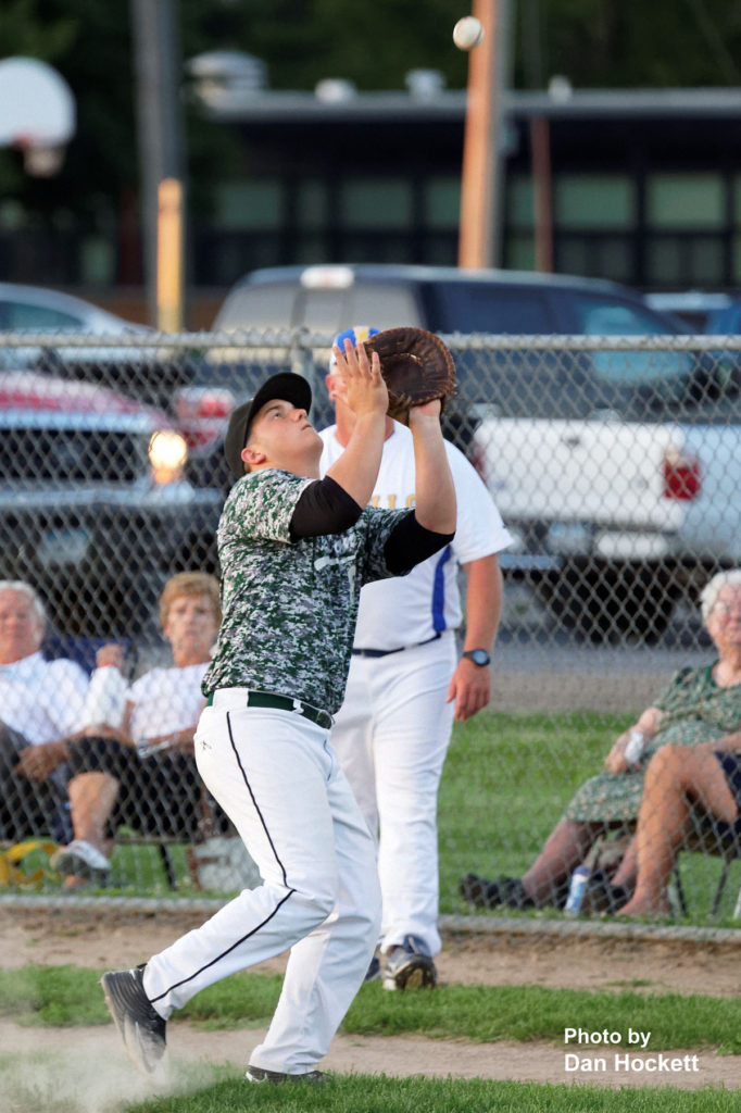 Photo by Dan Hockett West Burlington First Baseman Cam Guihan catches a popup foul ball for the out against Wapello in the Class 2A District-10 quarterfinal Saturday night in Wapello. Wapello defeated West Burlington, 2-0.