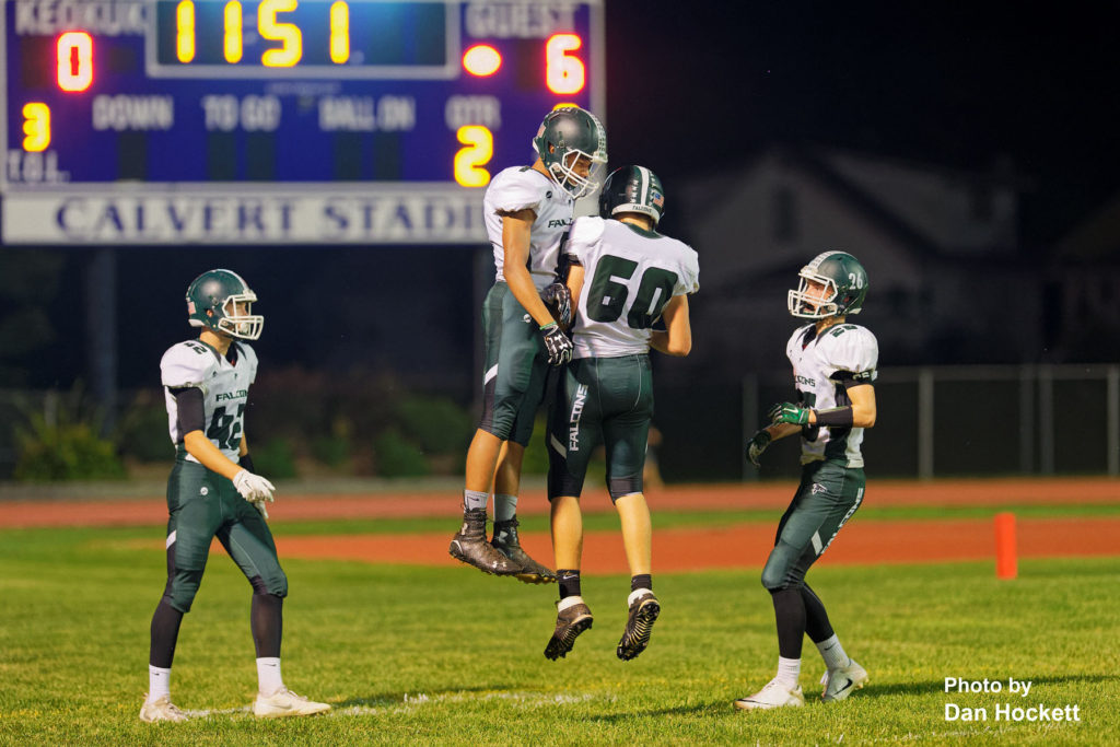 Photo by Dan Hockett West Burlington – Notre Dame Wide Receiver Rel Greer (7) jumps in celebration with Ryan McElderry (60) and Reece Richards (42) and Tanner Snodgrass (26) after scoring a touchdown Friday night in Keokuk. Keokuk defeated WBND, 24-21.