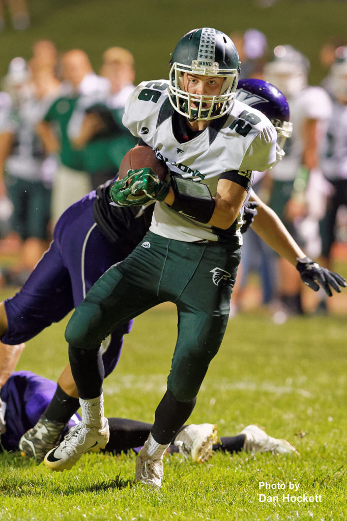 Photo by Dan Hockett West Burlington – Notre Dame Wide Receiver Tanner Snodgrass (26) turns up field after catching a pass Friday night in Keokuk. Keokuk defeated WBND, 24-21.