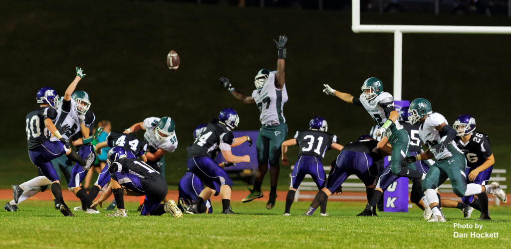 Photo by Dan Hockett Keokuk and West Burlington – Notre Dame Clash during a point after attempt Friday night in Keokuk. Keokuk defeated WBND, 24-21.