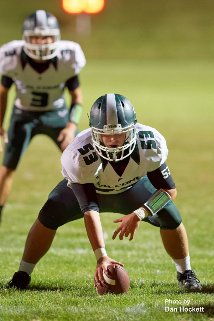 Photo by Dan Hockett West Burlington – Notre Dame Center Jacob Fritz (53) ready to hike the ball against West Branch Friday night in West Branch. WBND defeated No. 2 (1A) West Branch, 27-18.