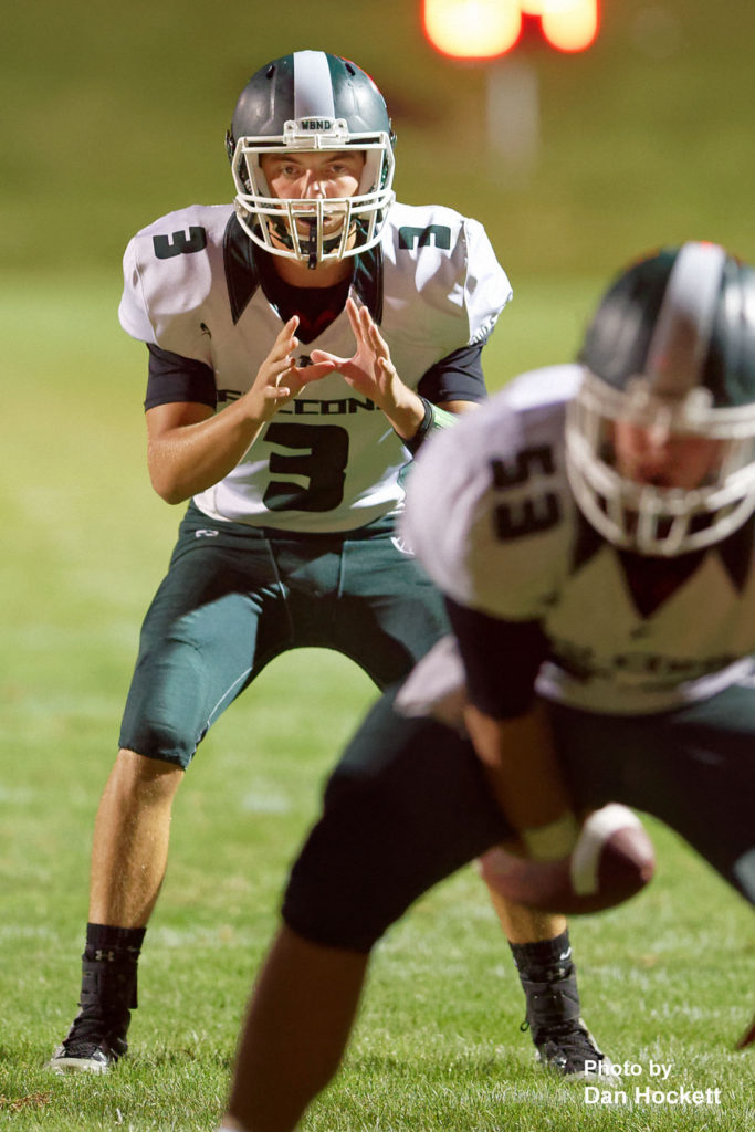 Photo by Dan Hockett West Burlington – Notre Dame Quarterback Drake Day takes the hike against West Branch Friday night in West Branch. WBND defeated No. 2 (1A) West Branch, 27-18.