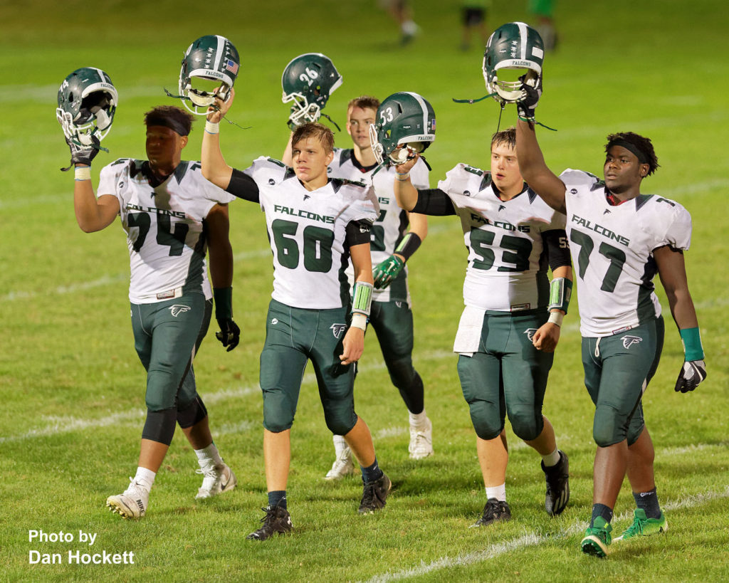 Photo by Dan Hockett West Burlington – Notre Dame Teammates salute the fans after defeating No. 2 Class 1A West Branch in West Branch Friday night, 27-18.
