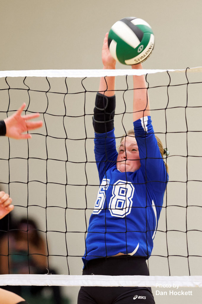 Photo by Dan Hockett Danville's Teagan Kruze (68) tries to block a West Burlington spike Tuesday night in West Burlington. West Burlington defeated Danville, 25-22, 23-25, 25-23, 25-19.