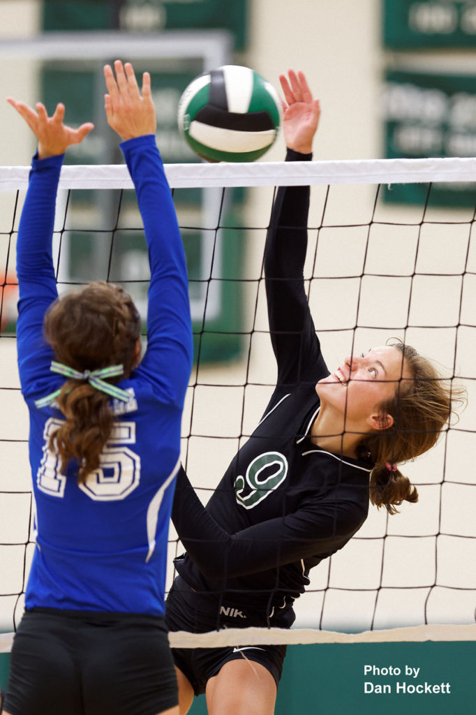 Photo by Dan Hockett West Burlington's Kinnady Atwater (9) hits ball over Danville's Grace Grothe (15) Tuesday night in West Burlington. West Burlington defeated Danville, 25-22, 23-25, 25-23, 25-19.