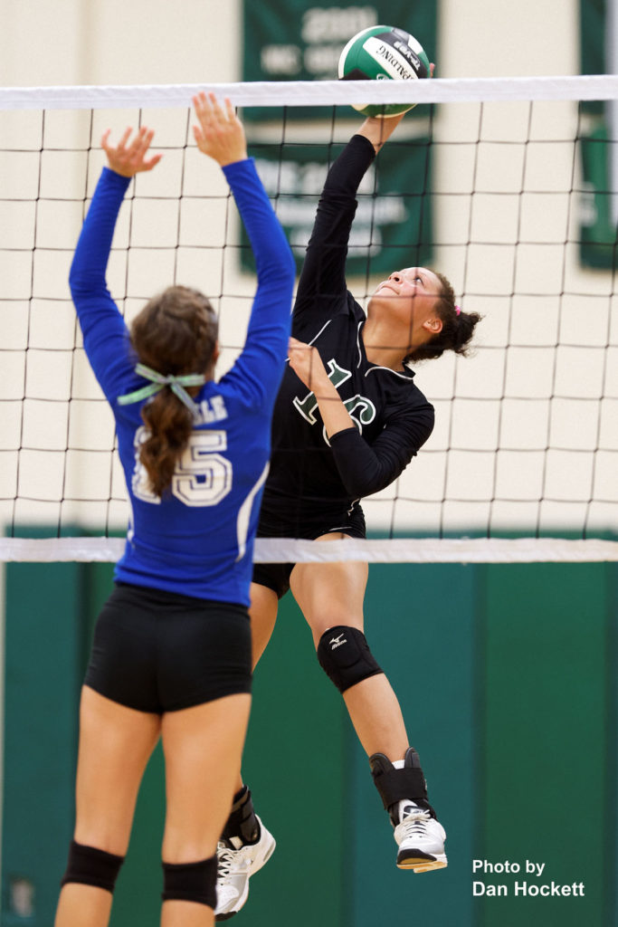 Photo by Dan Hockett West Burlington's Chloe Bake sends the ball over Danville's Grace Grothe (15) Tuesday night in West Burlington. West Burlington defeated Danville, 25-22, 23-25, 25-23, 25-19.