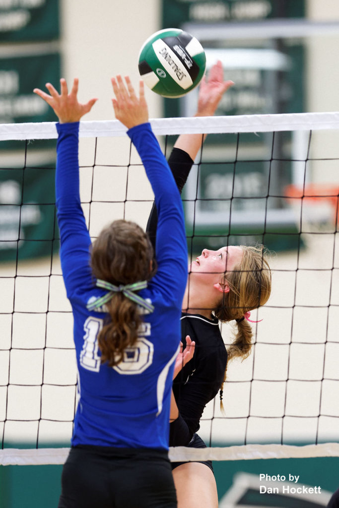 Photo by Dan Hockett West Burlington's Kamaryn Atwater sends the ball over Danville's Grace Grothe (15) Tuesday night in West Burlington. West Burlington defeated Danville, 25-22, 23-25, 25-23, 25-19.
