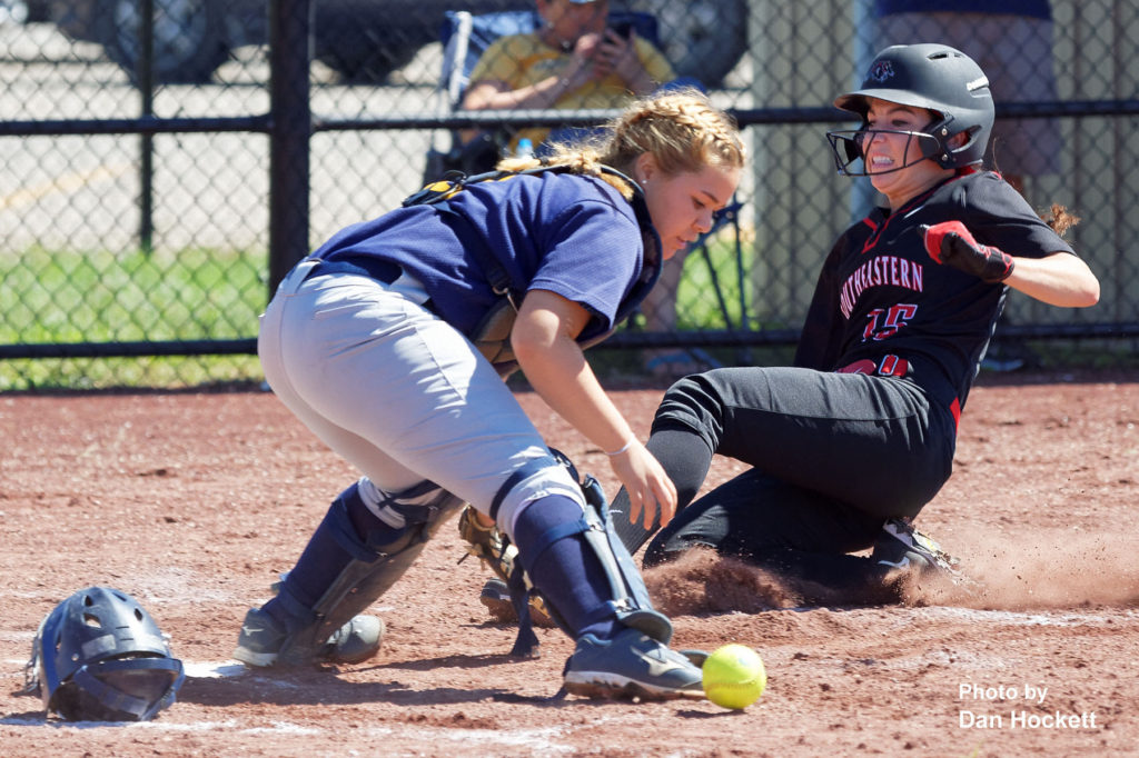 Photo by Dan Hockett SCC's Courtney Coffin slides safe at home in front of William Penn Catcher Jayleen Ovalles Sunday afternoon in West Burlington. Coffin is a former West Burlington – Notre Dame Softball Standout. SCC defeated William Penn in doubleheader, 11-4, 17-2.