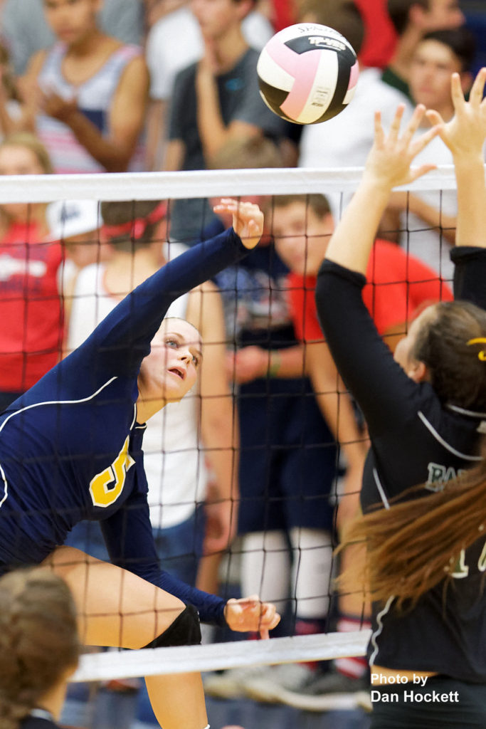 Photo by Dan Hockett Notre Dame's Riley Brueck sends the ball over the net against Notre Dame Thursday night in Burlington. 12th Ranked Notre Dame defeated West Burlington, 25-15, 25-8, 25-19.