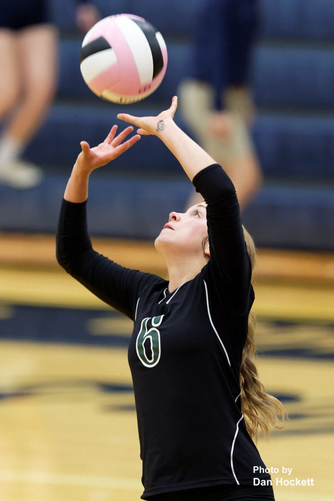 Photo by Dan Hockett West Burlington's Shayleigh Abbott sets the ball net against Notre Dame Thursday night in Burlington. 12th Ranked Notre Dame defeated West Burlington, 25-15, 25-8, 25-19.