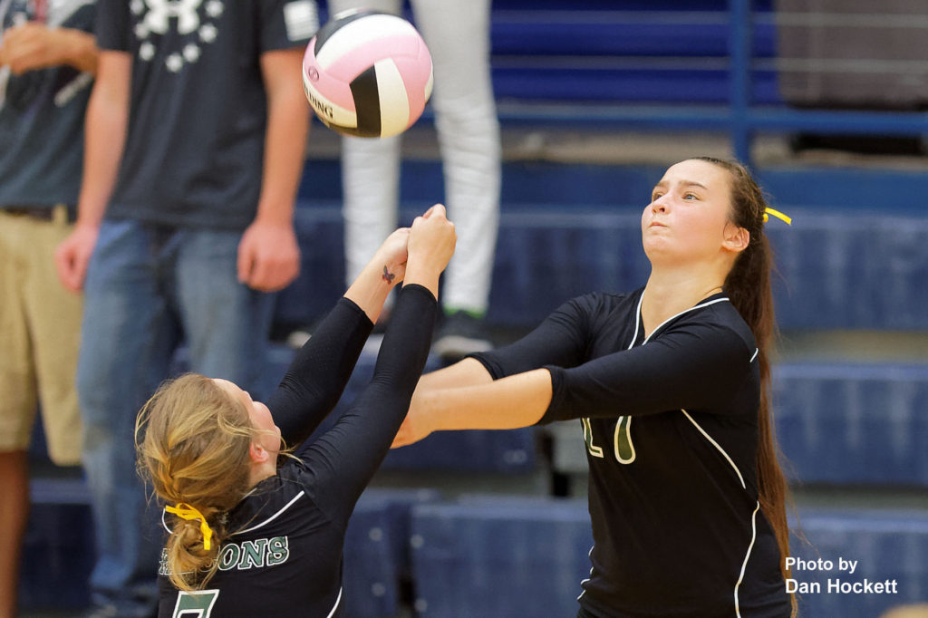 Photo by Dan Hockett West Burlington's Delaney Williams (right) and Bailey Jennings (left) keep the ball in play against Notre Dame Thursday night in Burlington. 12th Ranked Notre Dame defeated West Burlington, 25-15, 25-8, 25-19.