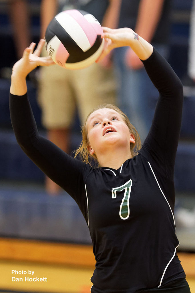Photo by Dan Hockett West Burlington's Bailey Jennings sets the ball against Notre Dame Thursday night in Burlington. 12th Ranked Notre Dame defeated West Burlington, 25-15, 25-8, 25-19.