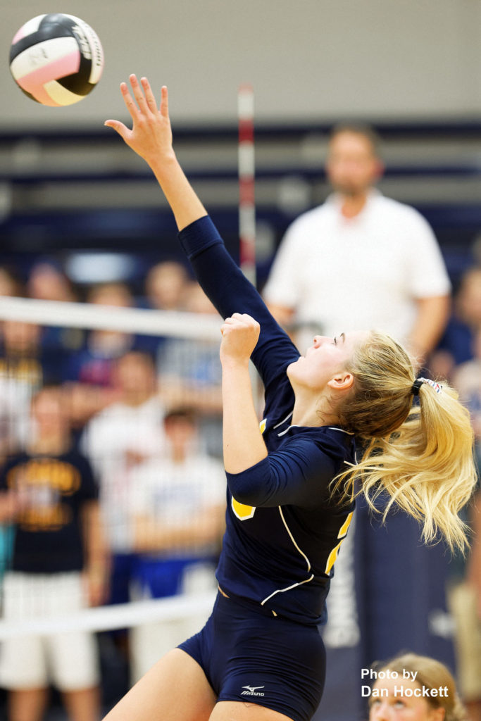 Photo by Dan Hockett Notre Dame's Emma Lynch sends the ball over the net against Notre Dame Thursday night in Burlington. 12th Ranked Notre Dame defeated West Burlington, 25-15, 25-8, 25-19.