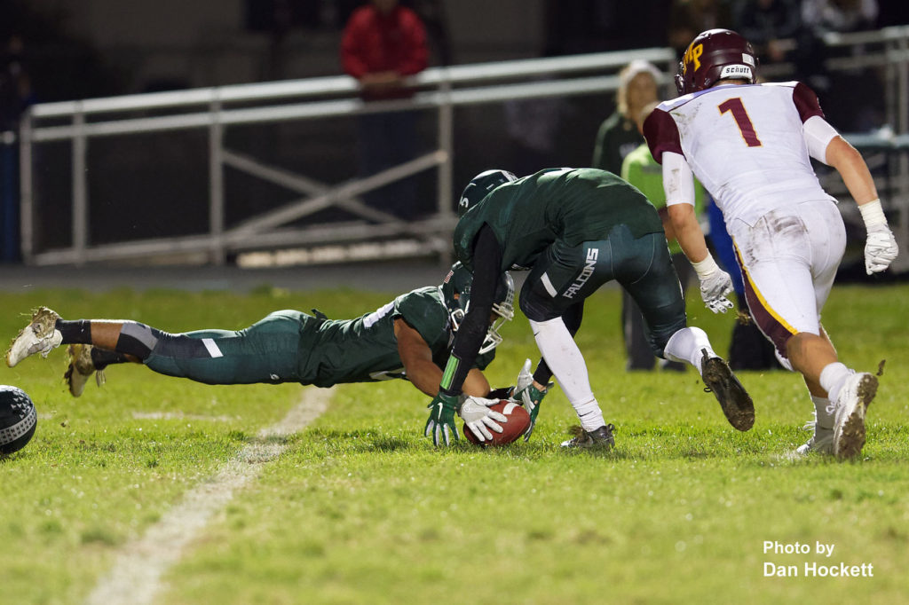 Photo by Dan Hockett West Burlington – Notre Dame's Brian Brem recovers a Mt. Pleasant fumble Friday night in West Burlington. Mt. Pleasant defeated WBND, 21-14.
