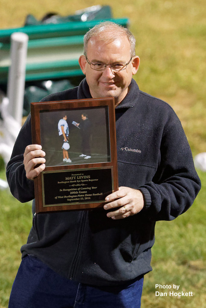 Photo by Dan Hockett Burlington Hawkeye Sports Reporter and West Burlington High School Graduate Matt Levins is awarded a plaque for covering 200-West Burlington – Notre Dame Games.