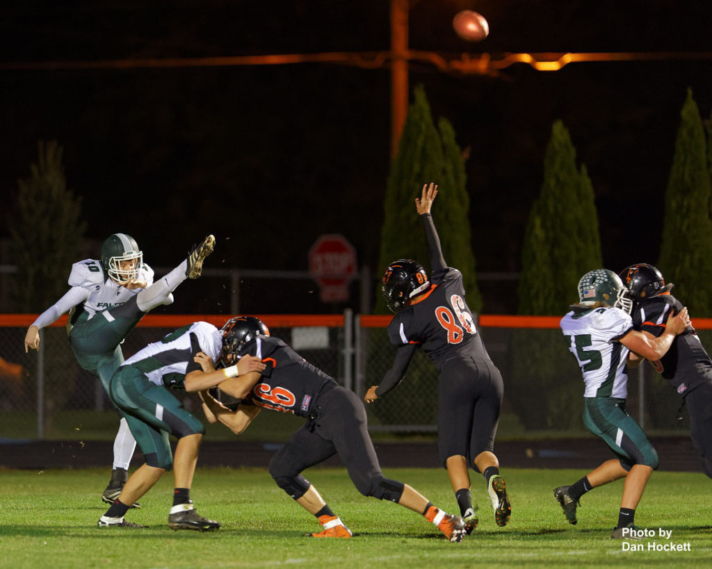 Photo by Dan Hockett West Burlington – Notre Dame Punter Slater Gifford (10) punts the ball back to Washington in the first quarter of Friday night's game in Washington. Washington defeated West Burlington – Notre Dame, 49-7.