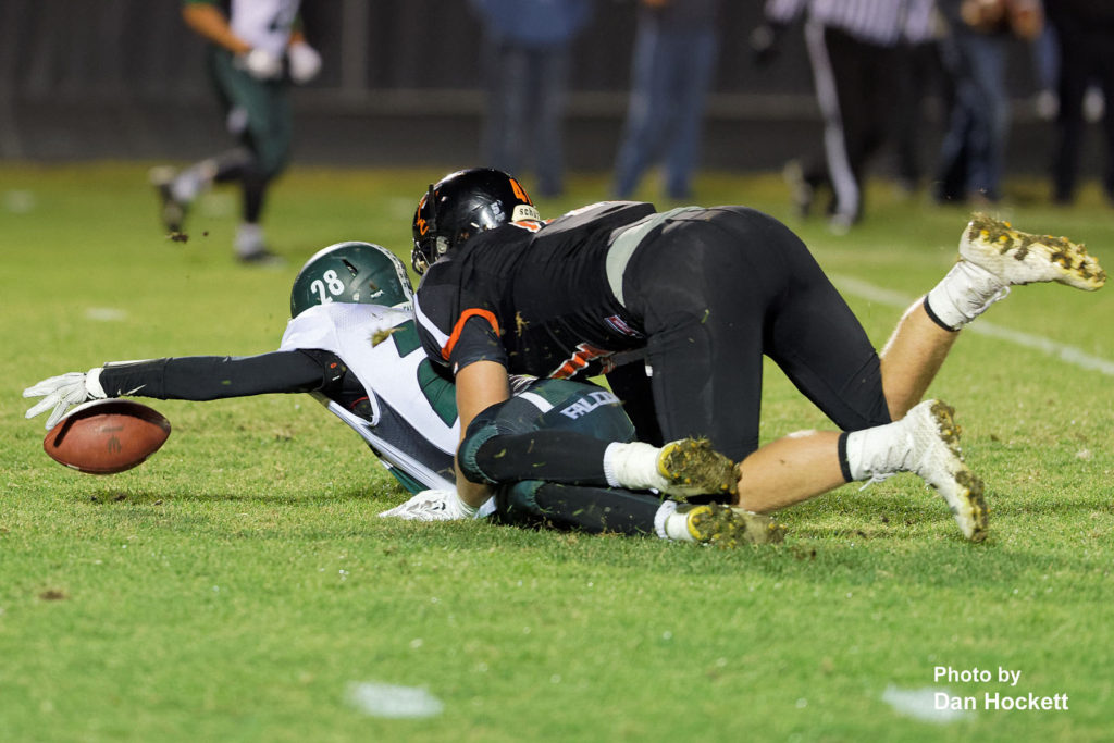 Photo by Dan Hockett West Burlington – Notre Dame Running Back Isaiah Trousil (28) tries to recover his fumble after catching a pass Friday night in Washington. Trousil's teammate Tanner Snodgrass recovered the fumble. Washington defeated West Burlington – Notre Dame, 49-7.