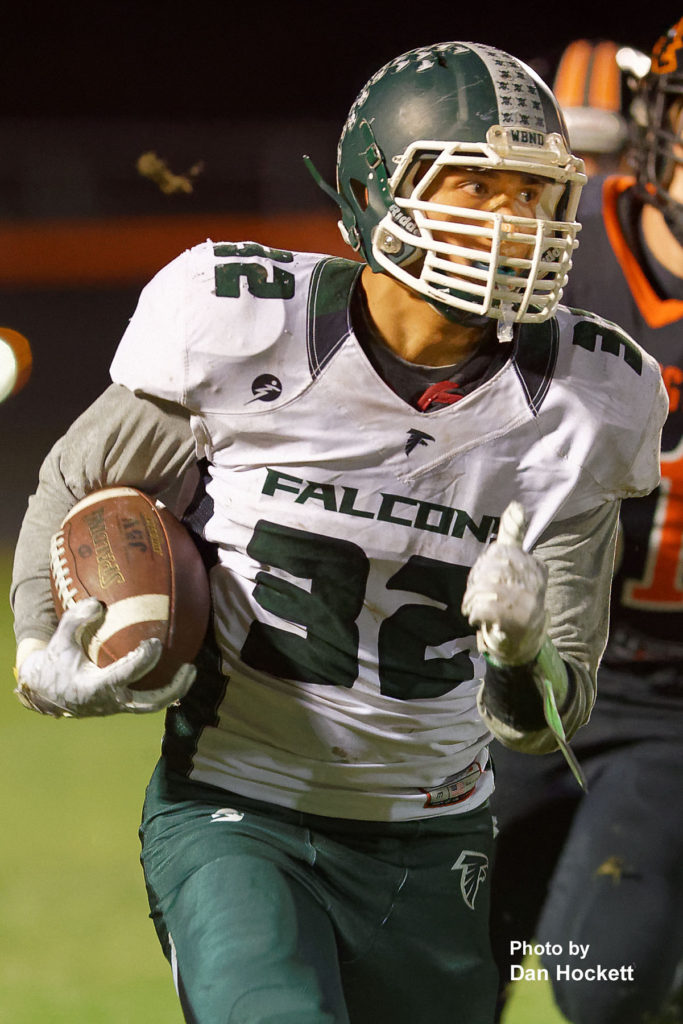 Photo by Dan Hockett West Burlington – Notre Dame Fullback Rodrigo Ramos (32) carries the ball against Washington Friday night in Washington. Washington defeated West Burlington – Notre Dame, 49-7.
