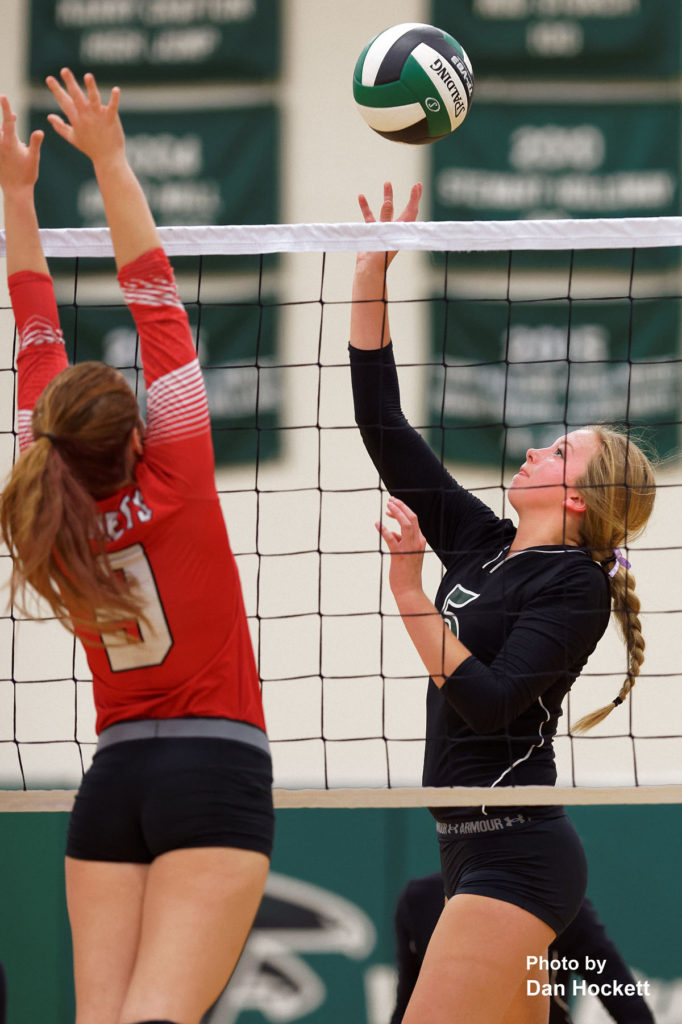 Photo by Dan Hockett West Burlington's Kamaryn Atwater taps the ball over the net against Cardinal Tuesday night in West Burlington. WB defeated Cardinal, 25-14, 23-25, 25-18, 25-14.