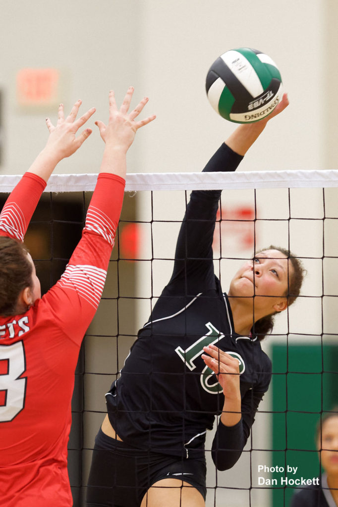 Photo by Dan Hockett West Burlington's Chloe Baker sends the ball over the net against Cardinal Tuesday night in West Burlington. WB defeated Cardinal, 25-14, 23-25, 25-18, 25-14.