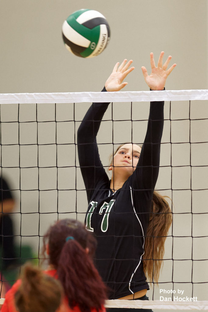 Photo by Dan Hockett West Burlington's Delaney Williams goes up to block a shot from Cardinal Tuesday night in West Burlington. WB defeated Cardinal, 25-14, 23-25, 25-18, 25-14.