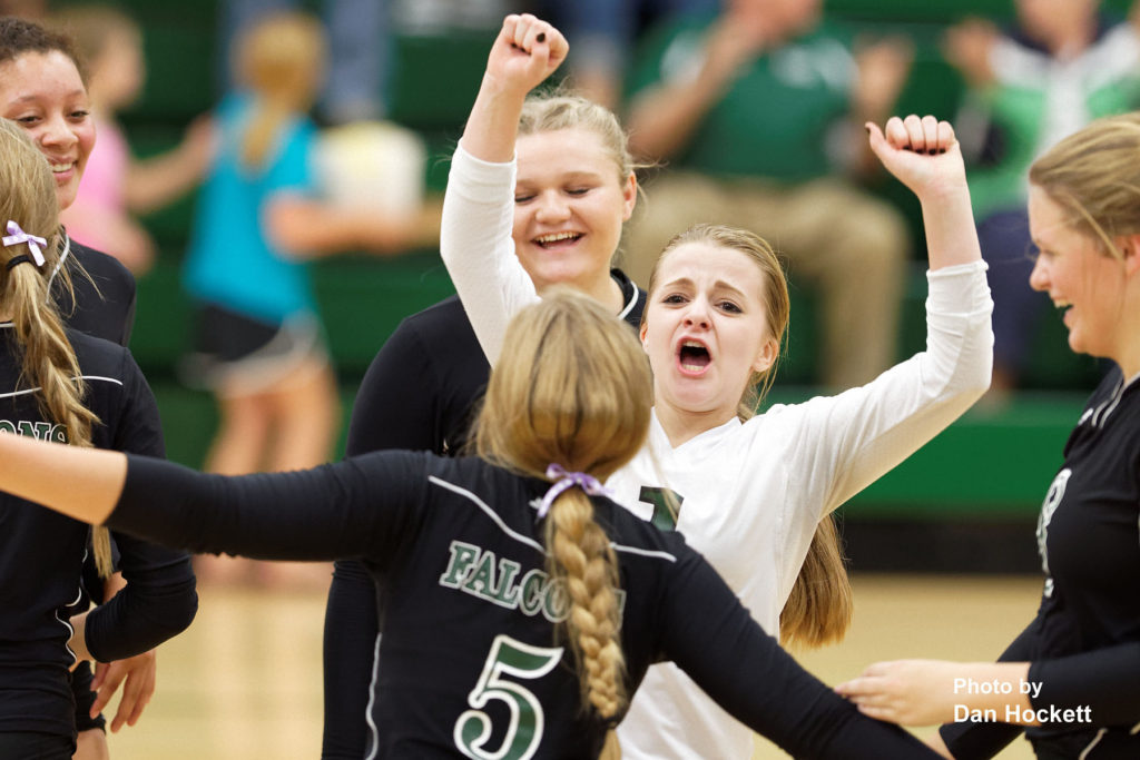 Photo by Dan Hockett West Burlington Libero Mckenzie Fry celebrates with teammate after defeating Cardinal Tuesday night in West Burlington. WB defeated Cardinal, 25-14, 23-25, 25-18, 25-14.