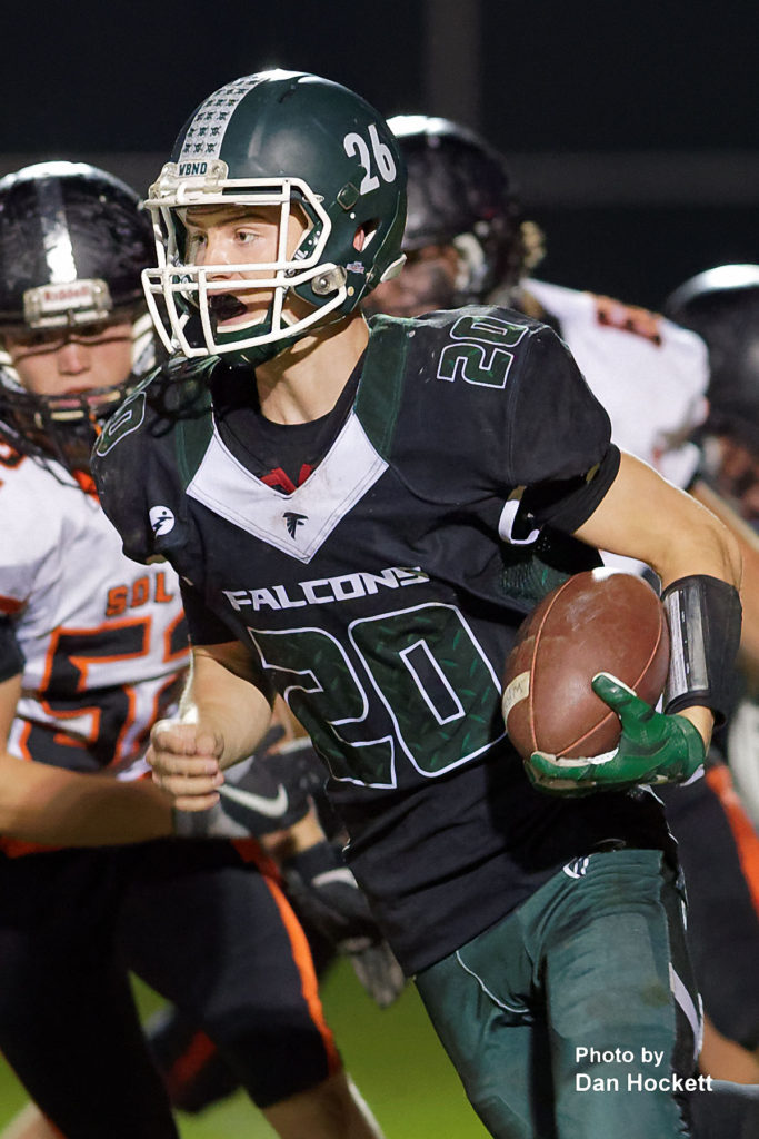 Photo by Dan Hockett West Burlington – Notre Dame Quarterback Tanner Snodgrass (20/26) carries the ball against Solon Friday night in West Burlington. No. 8 Solon defeated WBND, 42-0.