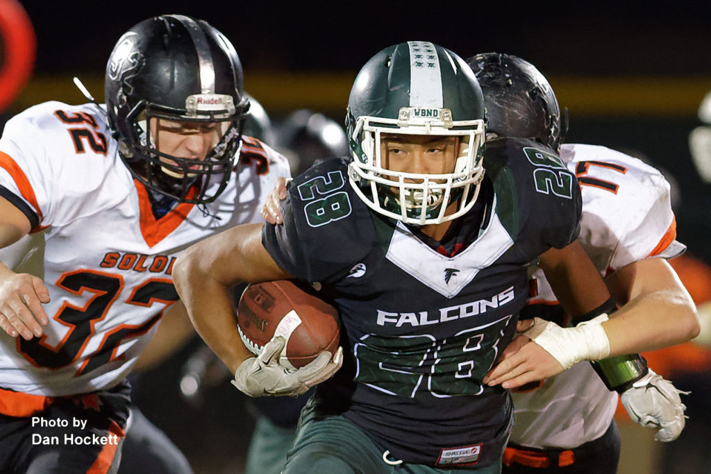Photo by Dan Hockett West Burlington – Notre Dame Running Back Isaiah Trousil (28) carries the ball against Solon Friday night in West Burlington. No. 8 Solon defeated WBND, 42-0.