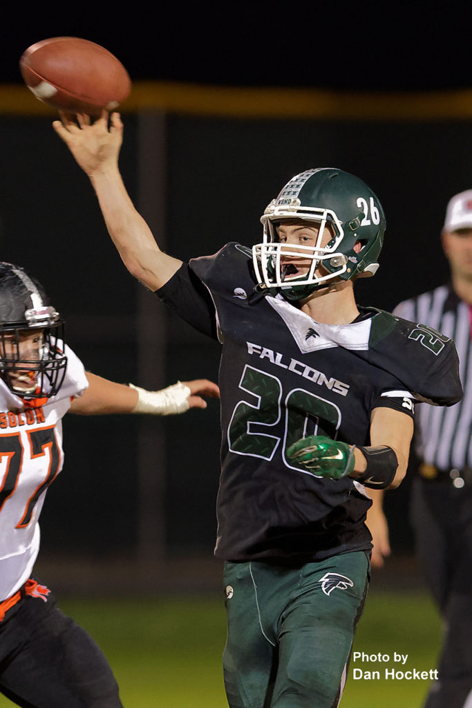 Photo by Dan Hockett West Burlington – Notre Dame Quarterback Tanner Snodgrass (20/26) passes the ball against Solon Friday night in West Burlington. No. 8 Solon defeated WBND, 42-0.