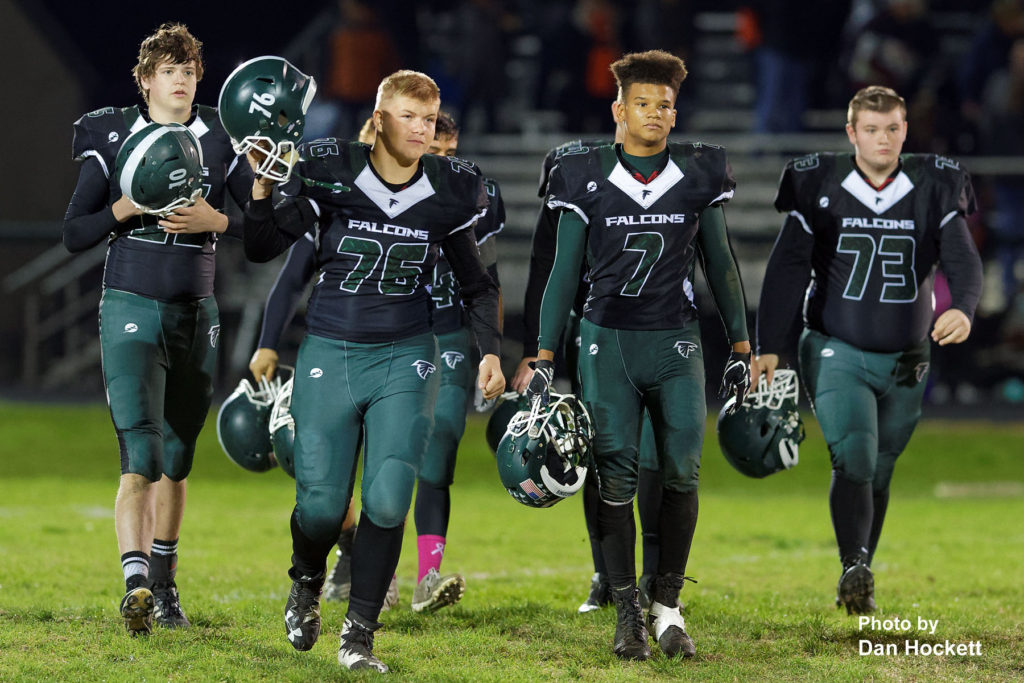 Photo by Dan Hockett West Burlington – Notre Dame's Slater Gifford (10), Conner Orth (76), Rel Greer (7), and Jonathan Mack (73) leave the field after a 42-0 loss to No. 8 Solon Friday night in West Burlington.