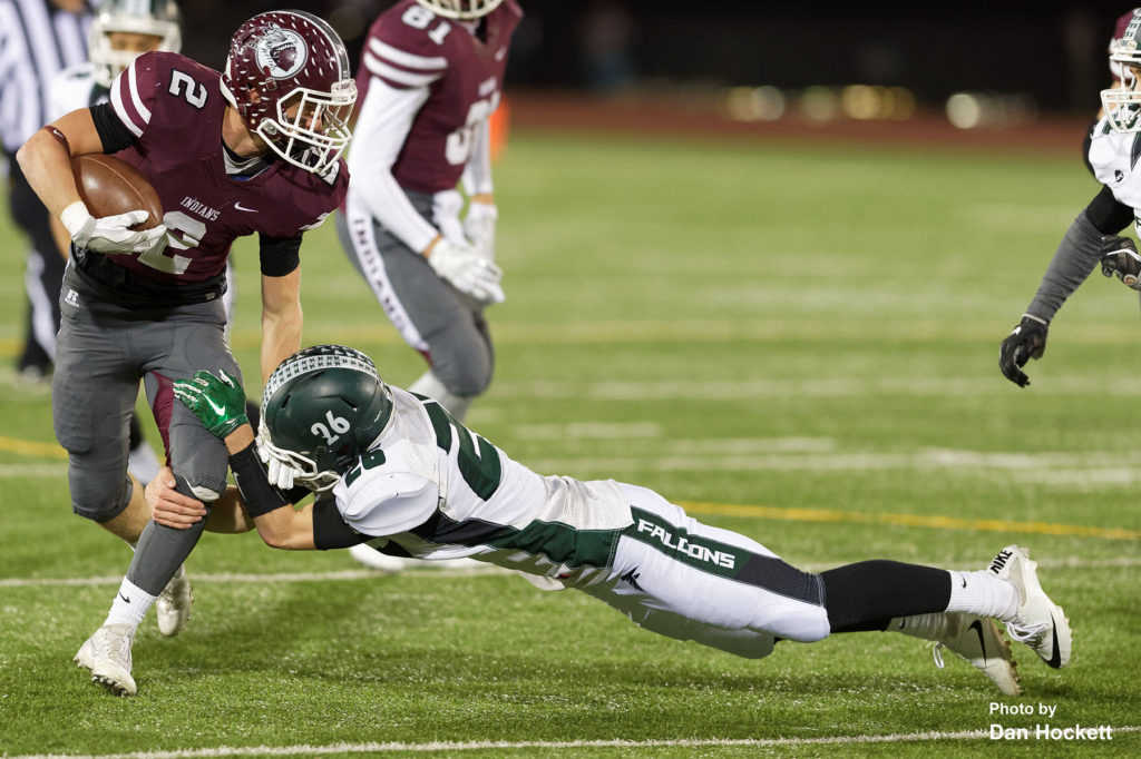 Photo by Dan Hockett West Burlington – Notre Dame's Tanner Snodgrass (26) tackles Oskaloosa Wide Receiver Bennett Spry (2) Friday night in Oskaloosa. Oskaloosa defeated West Burlington – Notre Dame, 47-6.
