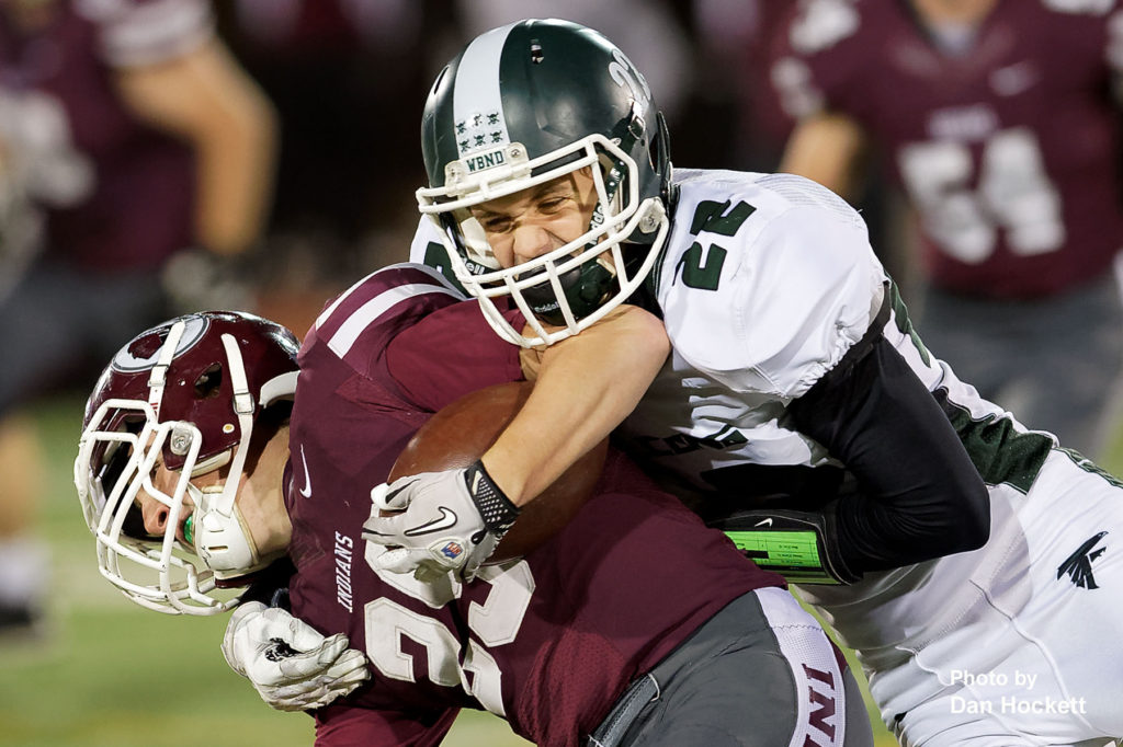 Photo by Dan Hockett West Burlington – Notre Dame Defensive Back Colten Hohenthaner (22) tackles Oskaloosa Wide Receiver Zaiyan Mamun (35) Friday night in Oskaloosa. Oskaloosa defeated West Burlington – Notre Dame, 47-6.