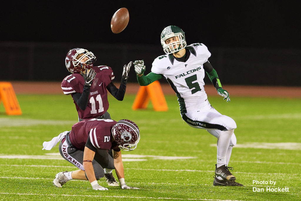 Photo by Dan Hockett West Burlington – Notre Dame Tight End Tate Snodgrass (5) watches as a tipped pass intended for him is intercepted by Oskaloosa Defensive Back Alex DeJong (11) Friday night in Oskaloosa. Oskaloosa defeated West Burlington – Notre Dame, 47-6.
