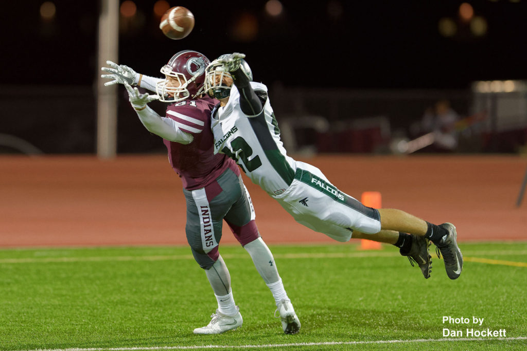 Photo by Dan Hockett West Burlington – Notre Dame Defensive Back Colten Hohenthaner (22) is called for pass interference in defending the end zone against Oskaloosa Wide Receiver Ethan Kelderman (81) Friday night in Oskaloosa. Oskaloosa defeated West Burlington – Notre Dame, 47-6.