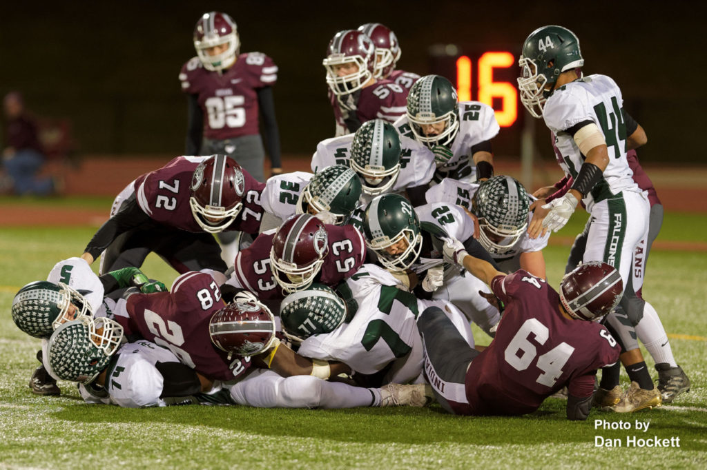 Photo by Dan Hockett A pile up occurs as Oskaloosa tries to score near the West Burlington – Notre Dame goal line Friday night in Oskaloosa. Oskaloosa defeated West Burlington – Notre Dame, 47-6.