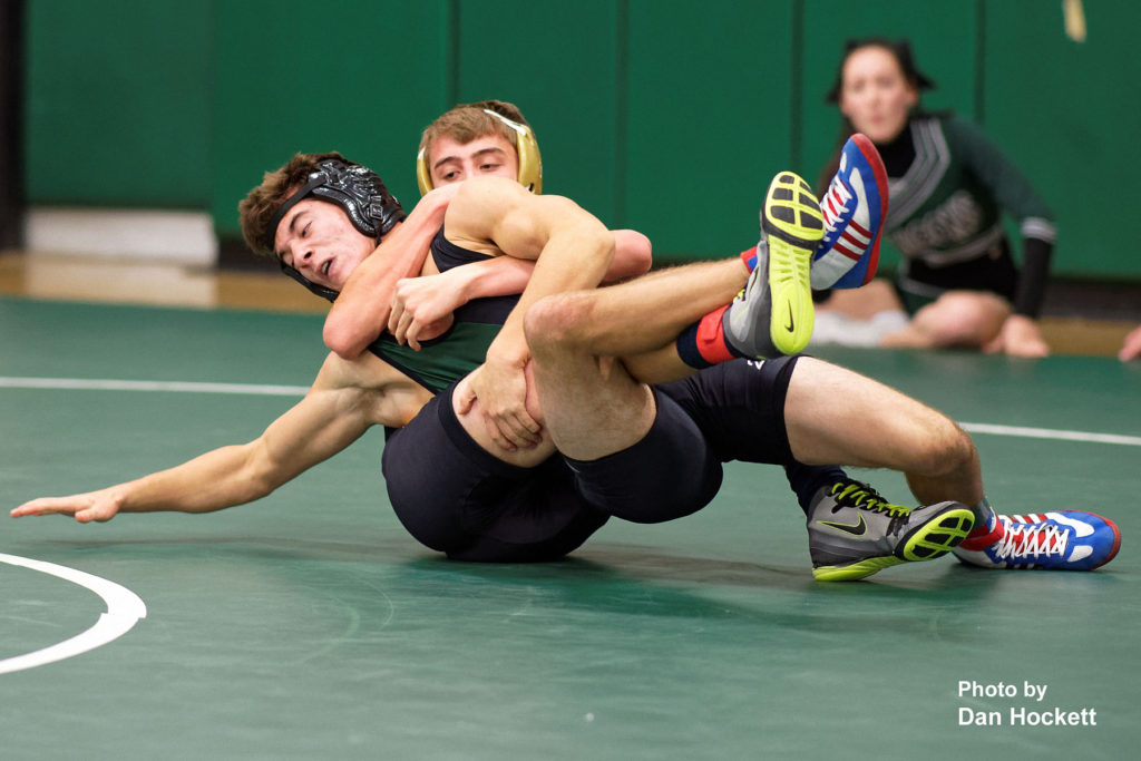 Photo by Dan Hockett New London 126-pounder Gabe Carter (rear) grapples with Falcon Wayne Briggs (front) Thursday night in West Burlington.  Carter defeated Briggs 12-2.  New London defeated WBNDD, 68-6.